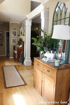 dresser, mirror, lamp, plant...