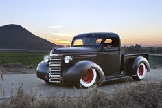 1939 Chevy- Flat black with white walls. Very clean. I've always wanted a classic pickup