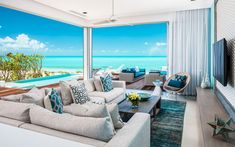 A luxury oceanfront villa in Turks & Caicos with a sleek modern design, seamless indoor/outdoor living areas and turquoise accents throughout. House Of Turquoise, Indoor Outdoor Living, Outdoor Living Areas, Pantone, Turks- Und Caicosinseln, Terrasse Design, Infinity Pool, Luxury Real Estate Agent, Villa