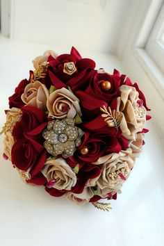 Wedding to Win the Oscars Beautiful red and gold wedding bouquet with jewels!Beautiful red and gold wedding bouquet with jewels! Gold Bouquet, Gold Wedding Bouquets, Bride Bouquets, Boquet, Brooch Bouquets, Red Rose Wedding Bouquet, Prom Bouquet, Gold Weddings, Burgundy And Gold