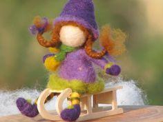 Needle felted doll on sledge van Made4uByMagic op Etsy