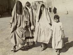 Jewish women wearing traditional clothes walk down