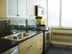 Grey concrete with custom birch cabinets work shop for Birch kitchen cabinets pros and cons