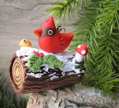 Tis the season to be making… this Yule log Cardinal ornament is a perfect project to make as a gift, embellish a present, or hang on your festive tree. Design bySwirly Designs by Lianne and Paul Stoddardwww.swirlydesigns.com Tips: Be sure to wash your hands after using the red color clays before handling the lighter clay