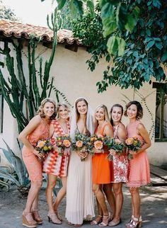 The Best Bridesmaid Looks: Our 10 Favorite Bridesmaid Trends This Year | We're sharing our 10 favorite bridesmaid trends, like these mix and match orange bridesmaids. We love the mixture of patterned dresses with sold styles.