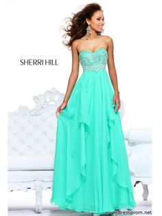 When you wear this delicate 2013 formal dress to your special day every single movement as you walk and dance will be complimented. Sherri Hill 3874 features beaded swirls that are formed on the fitted bodice with strapless sweetheart neckline. The empire waist welcomes the ethereal flowy skirt, with gentle side draping, that creates a graceful swish just as you wish. The available color options to choose from are Yellow, Coral, Light Blue, Lilac, Nude, Green and Pink. Make this look pop…