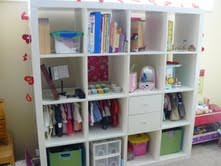 Here is a solution to storing all your daughters American Girl doll clothes, shoes and accessories. Turn an Ikea Expedit bookself into an American Girl Display.