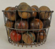 basket of vintage croquet balls