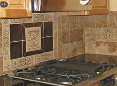 The Carved Pieces Are Done In Brown Ug And Mocha Cream Gl Plain Tiles Set Metallic Antique Br