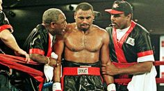 Oliver McCall crying in between rounds of his rematch vs. Lennox Lewis as trsiners George Benton and Greg Page attempt to console him.