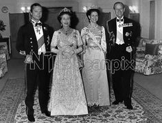 King Carl XVI Gustaf of Sweden, Queen Elizabeth II of UK, Queen Silvia of Sweden, and Prince Philip of UK at a dinner gala during the 1983 State Visit from UK to Sweden.