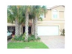 Nice townhouse with double garage in gated community.