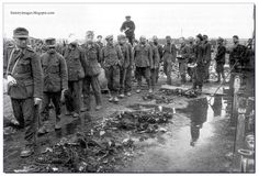 German POW are made to see the remains of the inmates of the Majdanek camp. Outskirts of the city of Lublin, Poland, 1944.