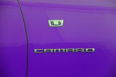 Purple Camaro with logo and badge. Chevrolet introduced the world to Camaro and a love affair was born.#camaro #chevrolet