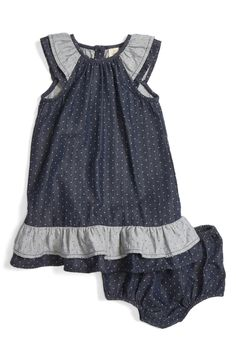 This sweet chambray shift dress patterned in playful polka dots features tiered contrast ruffles at the sleeves and hem.