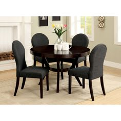 OVERSTOCK.COM The Magnolia Dining Set is a wonderfully crafted table and chair set that can fit in any dining room.  Fresh lines and a modern shape highlight simplicity of the whole dining set profile.