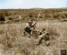 Australian infantryman gives a drink to a wounded Turkish soldier during the Gallipoli Campaign, Turkey, 1915