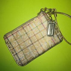 Coach Wristlet Gold cream and plaid wristlet with strap. Coach Bags Clutches & Wristlets