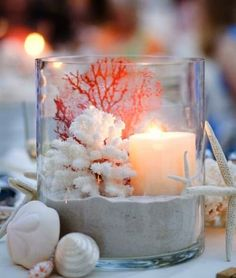 Candle centerpiece with sand and Coral in a large vase