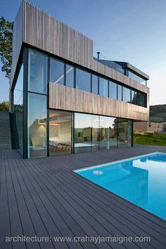 Love the wood/window association .