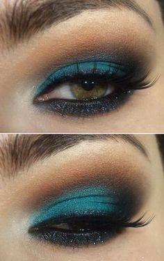 Blue eyeshadow with glitter eyeliner.