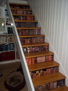Stairs with fake bookcase decoupaged to it