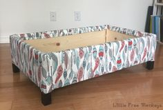 Make your own DIY upholstered storage ottoman starting with lumber from the store - it is super easy! This tutorial covers everything!…