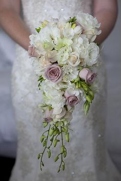 This shape for my wedding bouquet, mine will be fuller though. The flowers will be all white and ivory with some green. Also it will have my grandmother McDonough's locket attached, which has a picture of my Dad and I inside :)