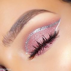 Pink eye look with silver outline for an eye catching wing.