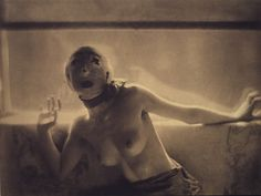 Dance Study, ca. 1912 | Adolph de Meyer photographed the dancer Nijinsky and other members of Diaghilev's Ballets Russes when L'après-midi d'un faun was presented in Paris in 1912. This photograph, the only nude by de Meyer, most likely portrays one member of the troupe in a costume whose source remains mysterious.