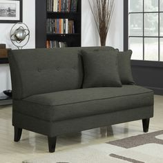 Add a touch of streamlined elegance to your living room or den with this Portfolio Engle armless loveseat. It features a linen-look upholstery and button-tufted back that makes it stand out, and it comes with two throw pillows to complete the look.