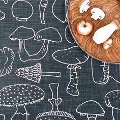 "A line of aprons and tea towels / ""Mushrooms"" print"