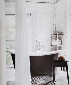 The Italian designer Paola Navone has designed a black and white house, playing with shades of gray in Umbria, Italy. Bad Inspiration, Bathroom Inspiration, White Bathroom, Small Bathroom, Brick Bathroom, Bathroom Ideas, Italian Bathroom, Relaxing Bathroom, Loft Bathroom