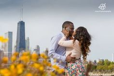 Fall engagement session  Engagement Session in Chicago  couple kissing with Hancock tower in background   Photo by Doru Halip for http://www.h.photography