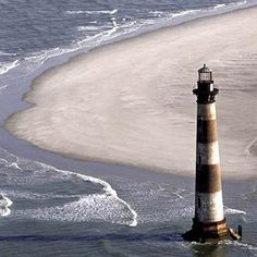 Morris Island light house :Charleston, South Carolina went to the top of it when I was 15 , can't do that today.