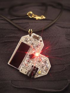 Blinking White and Gold Heart Electronic Necklace, Solar Powered.
