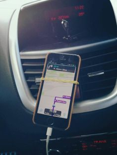 No phone holder? No problem. Thread a rubber band through your car vent to stabilize your phone.