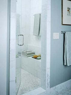 An enclosed shower can become a private getaway, even in a crowded home. An in-shower bench pulls double duty as storage and seating.…