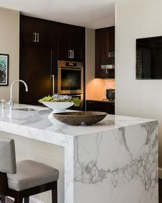 Terrat Elms Interior Design - kitchens - waterfall edge counter, marble waterfall edge counter, thick marble countertop, gray leather counte...