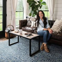 magnolia homes joanna gaines Joanna Gaines Introduces the 1 Thing You Need to Transform a Room Dark Leather Couches, Dark Brown Sofas, Brown Leather Couch Living Room, Living Room Decor For Brown Couches, Decor With Brown Couch, Brown And Blue Living Room, Brown Couch Pillows, Leather Living Room Furniture, Magnolia Home Collection