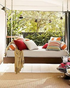 If you like the idea of naps on your covered patio, consider hanging a bed from the ceiling with sturdy hardware that can take the load. Then load that thing up with soft pillows, jump on and enjoy the luxury of being rocked to sleep while listening to the chirping of birds. Perfect for naps and reading!