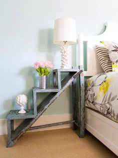 No Nightstand, No Problem  Don't rush out to buy new furniture if your guest bedroom is missing a few pieces — just improvise. Designer Erinn Valencich brought in a weathered garden step to serve as a bedside table. Its rustic patina adds charm while the steps create display space.