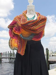 The Fiesta Scallop Shawl makes full use of the long color runs in Red Heart…