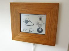 A neat little hanging weather station using a picture frame and a kindle.... super neat idea!