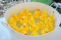 Duck pond game - if you fish out a duck with a sticker underneath, you win a prize