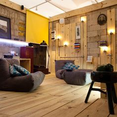 multimedia library where pine floorboards and industrial lighting climb the walls..so rustic yet modern