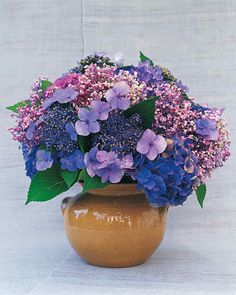 Hydrangea Arrangement | Martha Stewart Living - By late summer, these hardy shrubs are bursting in riotous colors and textures. In this arrangement, soft lavender mopheads pop out.
