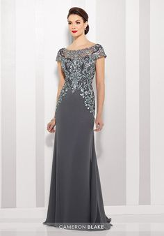 Chiffon slim A-line gown with lace illusion cap sleeve and bateau neckline over a sweetheart bodice, dropped waist, V-back, sweep train. Matching shawl included.