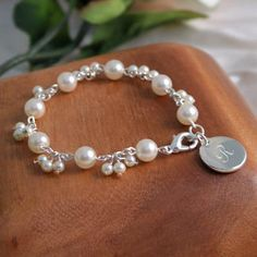 Both whimsical and sophisticated, our personalized Romance Pearl Bracelet is a must have! With its charming combination of glass pearls and dangling details, this dreamy bracelet makes a perfect accessory to any bridesmaid's jewelry collection. Resin Jewelry, Boho Jewelry, Bridal Jewelry, Fine Jewelry, Silver Jewelry, Jewellery, Silver Bracelets, Bridesmaid Bracelet, Bridesmaid Gifts
