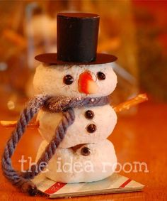 Powdered Donut Snowmen (I'd make his lil' scarf out of fruit leather or licorice, his hat out of PB cups & give him gum drop mittens. :)